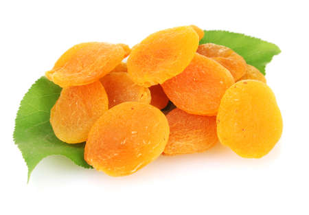 delicious dried apricots on green leaves isolated on white photo