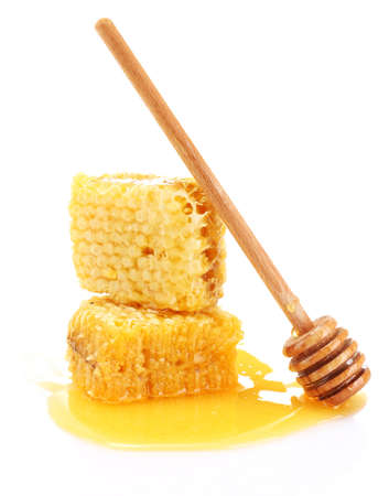 golden honeycombs with honey isolated on white Stock Photo - 14157599