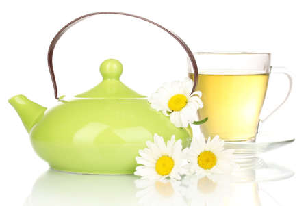 Teapot and cup with chamomile tea isolated on white Stock Photo - 14157479