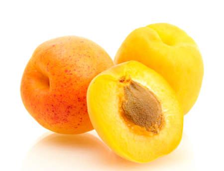ripe sweet apricots isolated on white photo