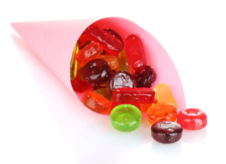 Tasty colorful candies in bright bag isolated on white photo