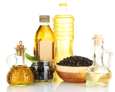 Olive and sunflower oil in the bottles and small decanters isolated on white photo