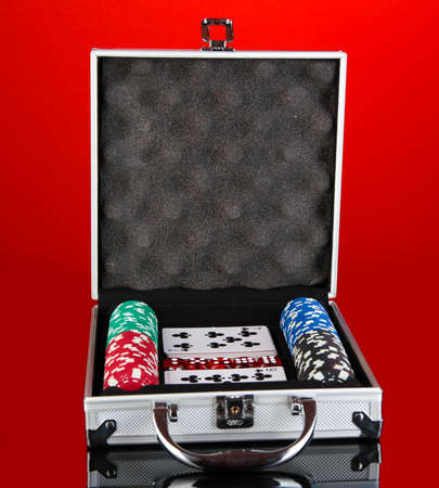 Poker set in metallic case on bright red background Stock Photo - 14158617