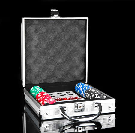 Poker set in metallic case isolated on black background photo