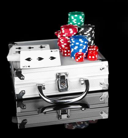 Poker set on a metallic case isolated on black background Stock Photo - 14157677