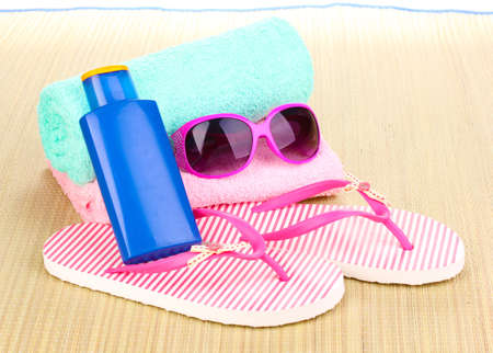 Beach accessories on mat photo