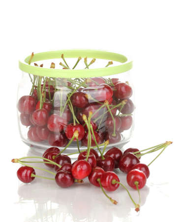Ripe cherry berries in jar isolated on white photo