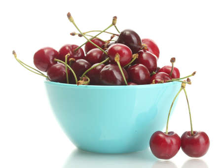 Ripe cherry berries in bowl isolated on white photo
