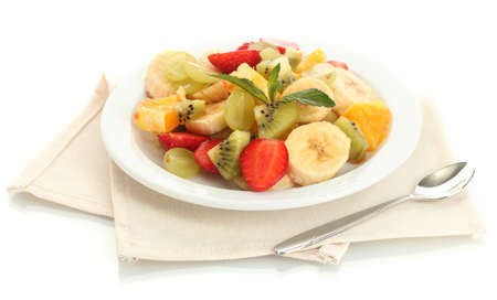 Fresh fruits salad on plate isolated on white photo