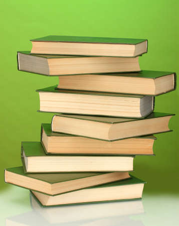 Tower of books on green background photo