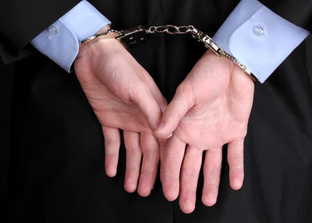 Businessman hands fettered with handcuffs Stock Photo - 14163601