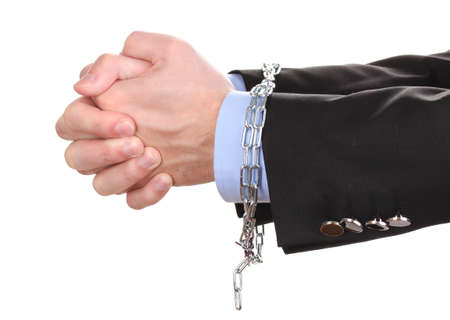 Businessman hands fettered with chain isolated on white Stock Photo