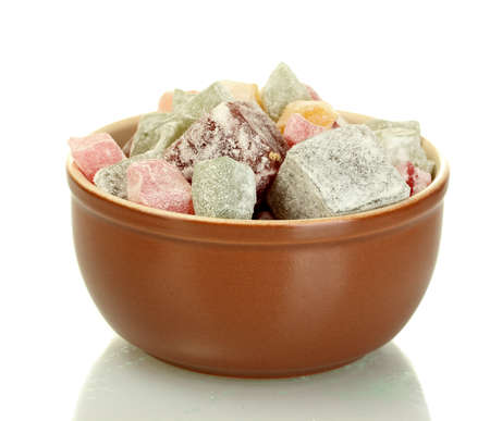 Bowl with delicious turkish delight isolated on white close-up photo