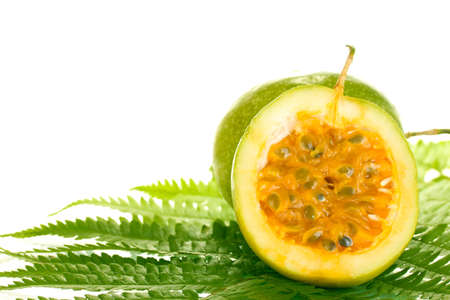 green passion fruit on white background close-up photo