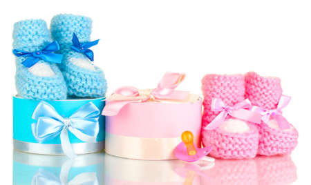 baby boots, pacifier, gifts and blank postcard  isolated on white photo