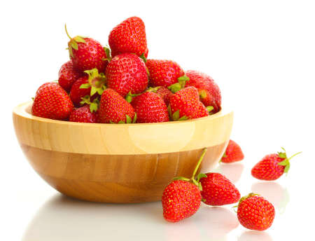 sweet ripe strawberries in wooden bowl isolated on white Stock Photo - 14179500