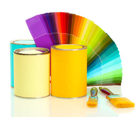 paint samples: tin cans with paint, brushes and bright palette of colors isolated on white