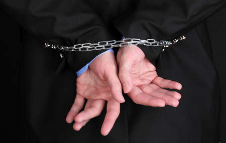 Businessman hands fettered with chain Stock Photo