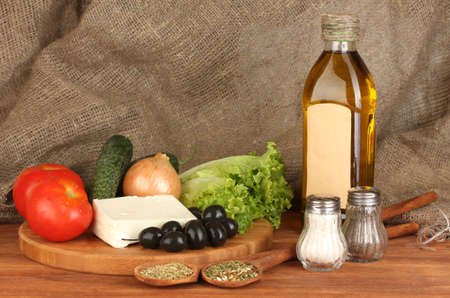Ingredients for a Greek salad on canvas background close-up photo