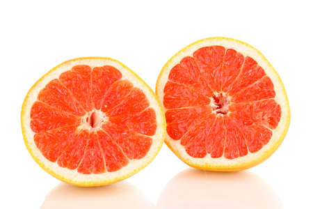 Two halves of ripe grapefruit isolated on white photo