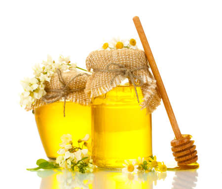 Sweet honey jars and acacia flowers isolated on white photo