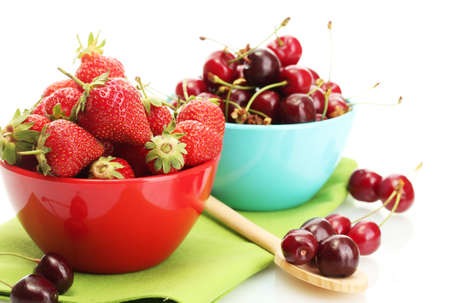 Ripe strawberries and cherry berries in bowls isolated on white Stock Photo - 14221160