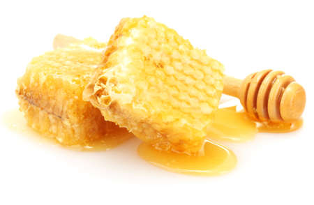 honey comb: golden honeycombs and wooden drizzler with honey isolated on white  Stock Photo
