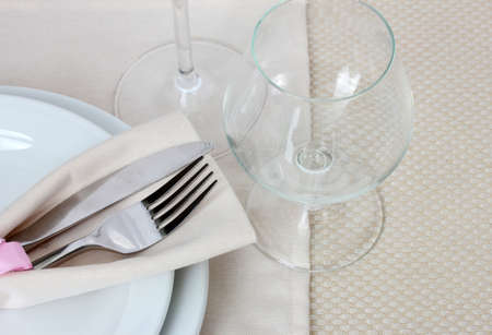 Table setting with fork, knife, plates, and glasses photo