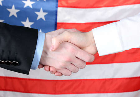 business handshake on american flag background stock photo picture