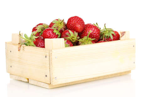 Sweet ripe strawberries in crate isolated on white photo