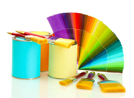 tin cans with paint, brushes and bright palette of colors isolated on white photo