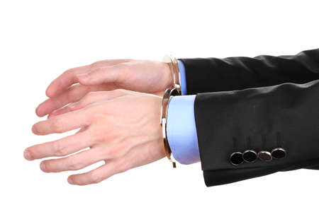 Businessman hands fettered with handcuffs isolated on white Stock Photo - 14222765