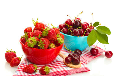 Ripe strawberries and cherry berries in bowls isolated on white Stock Photo - 14272805