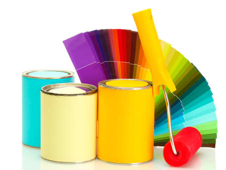 tin cans with paint, roller, brushes and bright palette of colors isolated on white photo