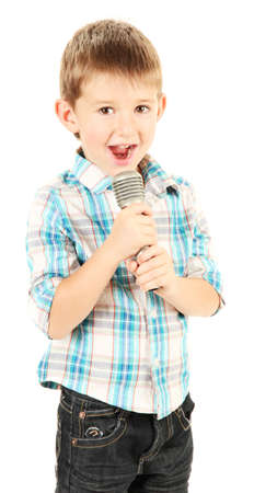 child singing: funny little boy with microphone, isolated on white