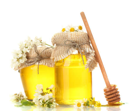 Sweet honey in jars and acacia flowers isolated on white photo