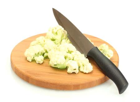 Fresh cauliflower and knife on cutting board isolated on white photo