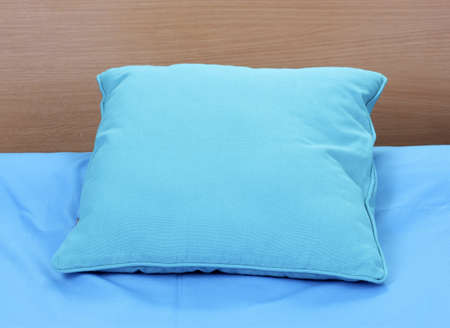 bright pillow on bed photo