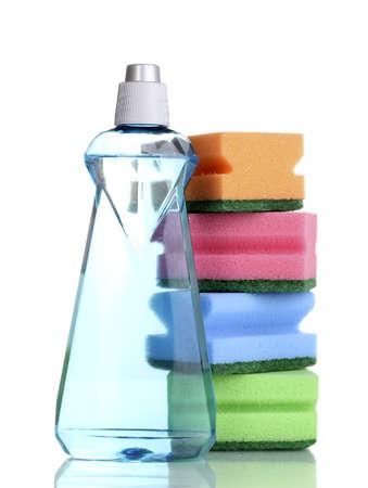 Dishwashing liquid and sponges isolated on white photo