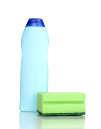 Dishwashing liquid and sponge isolated on white photo