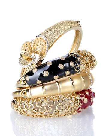 Beautiful golden bracelets isolated on white Stock Photo - 14321787
