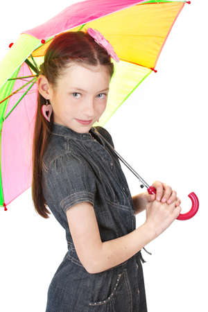 Portrait of beautiful little girl with umbrella Isolated on white photo