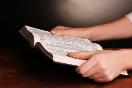 Hands holding russian holy bible photo