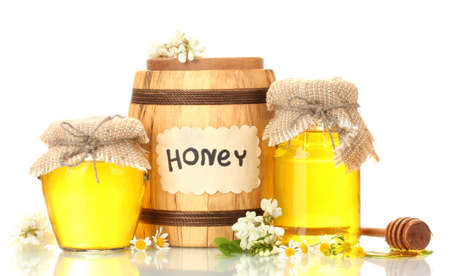 honeyed: Sweet honey in barrel and jars with acacia flowers isolated on white
