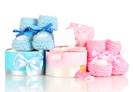 bootee: baby boots, pacifier, gifts and blank postcard  isolated on white