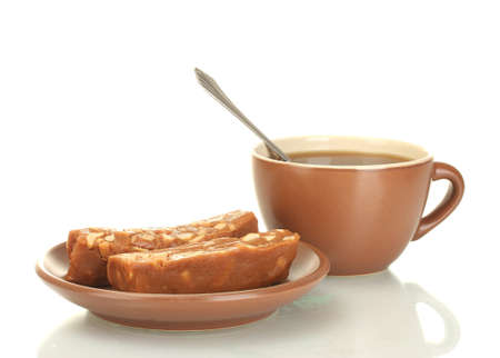 sorbet: Filiżanka herbaty i spodek z pyszne sorbety na białym
