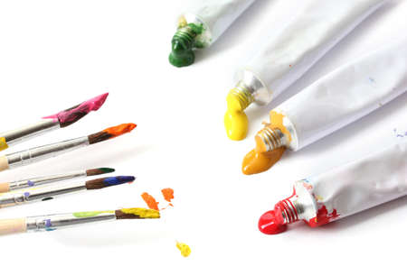 Abstract acrylic paint, paint tubes and brushes isolated on white photo