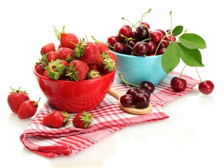 Ripe strawberries and cherry berries in bowls isolated on white Stock Photo - 14343136