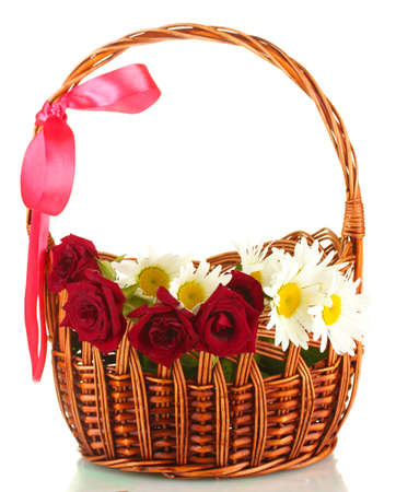 a basket of roses and daisies isolated on white background close-up photo