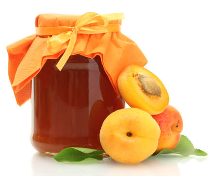 palatable: Apricot jam in a jar and sweet apricots isolated on white